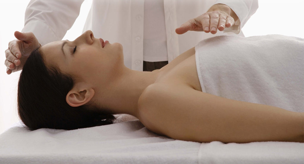 Woman having a reiki treatment